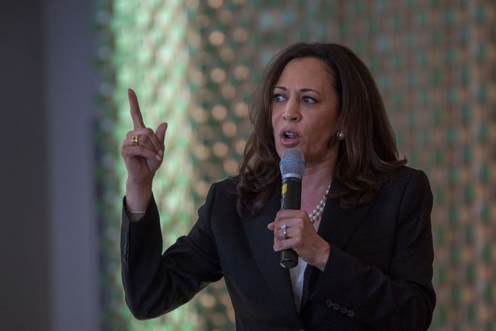kamala harris with a microphone