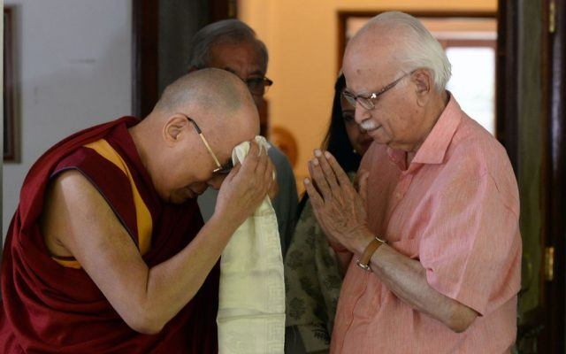 Exiled Tibetan spiritual leader the Dalai Lama (L) greets Lal Krishna Advani