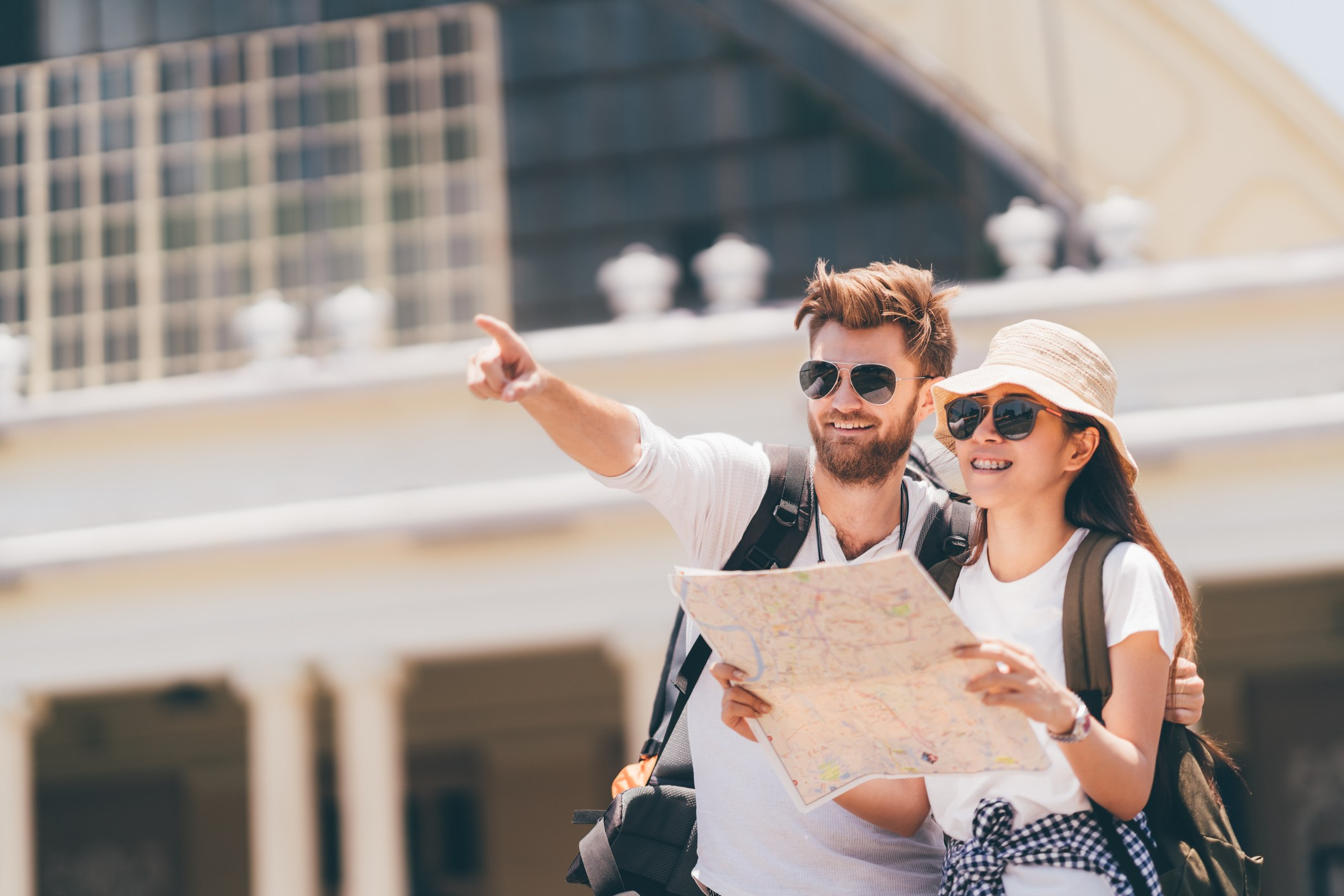 two tourists with a map