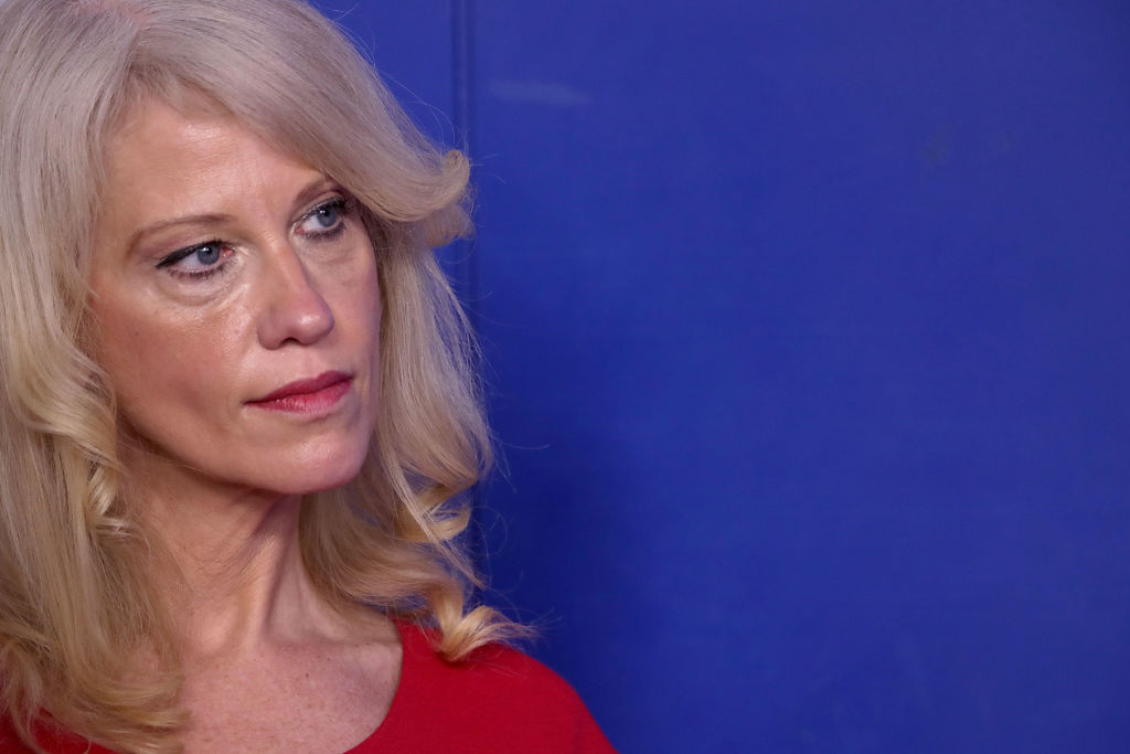 kellyann conway in red against a blue background