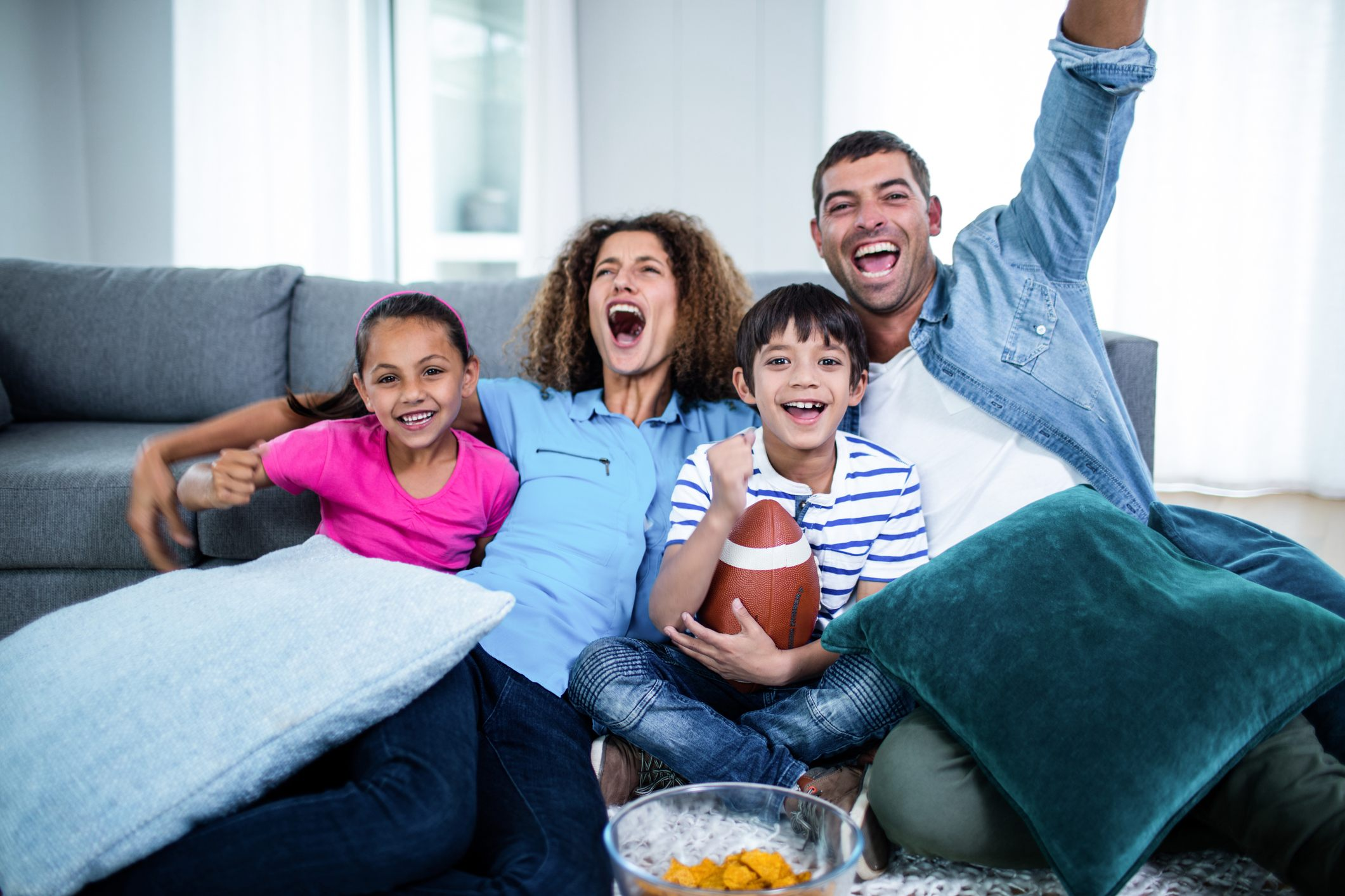 family watching football on the couch