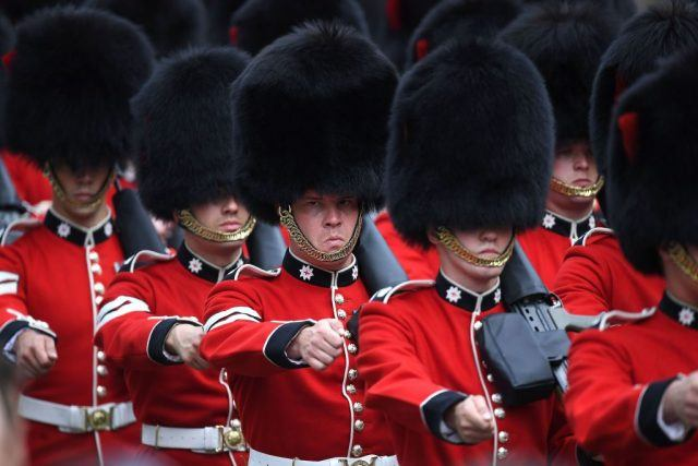Coldstream Guards march into position outside the Houses of Parliament during the State Opening of Parliament in London.