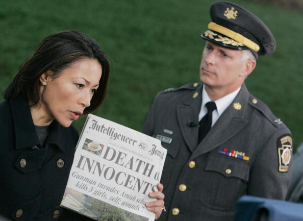 ann curry with a newspaper