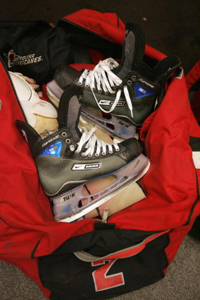 skates inside a red duffle bag