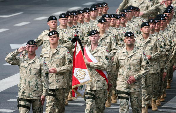 Polish soldiers march during a military parade.