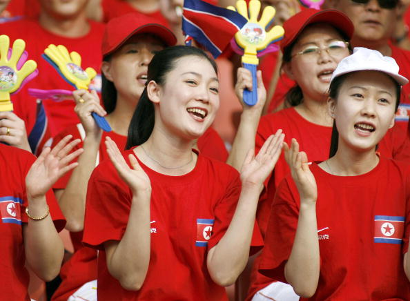North Korean cheerleaders show their support to their team before the quarter-final match against Germany in the FIFA Women's Football World Cup in Wuhan, in 2007
