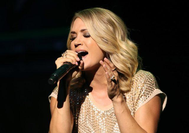 Carrie Underwood performing on stage.