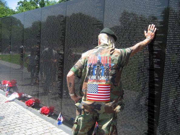 War veteran of World War II, Korea and Vietnam, Elton Ensor, 83, Navy frogman and SEAL, leans against the Vietnam Memorial Wall in Washington, DC