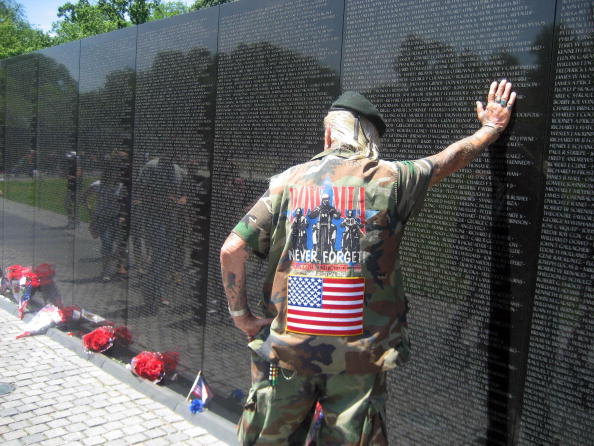 War veteran of World War II, Korea and Vietnam, Elton Ensor, 83, Navy frogman and SEAL, leans against the Vietnam Memorial Wall in Washington, DC