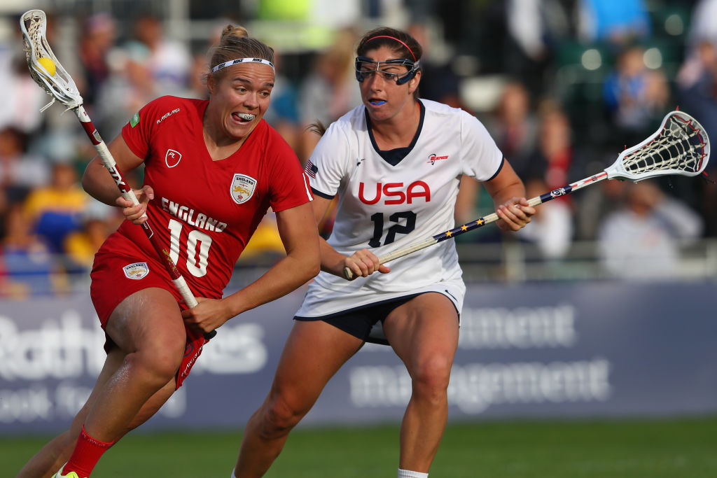 Annie Hillier (L) of England is tracked by Kayla Treanor (R) of USA during the semi-final match between England and USA during the 2017 FIL Rathbones Women's Lacrosse World Cup.