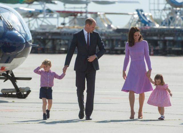 Prince William, Kate Middleton, and their kids at an airport.