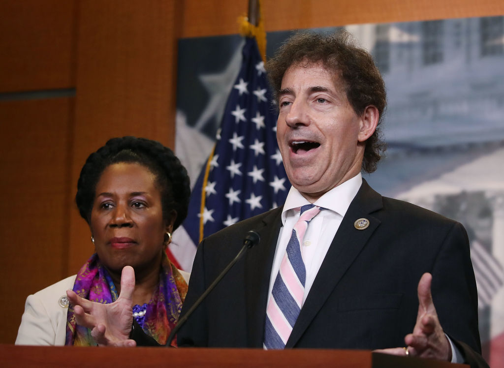 Jamie Raskin speaks while flanked by ranking member U.S. Rep. Sheila Jackson Lee during a news conference on Capitol Hill