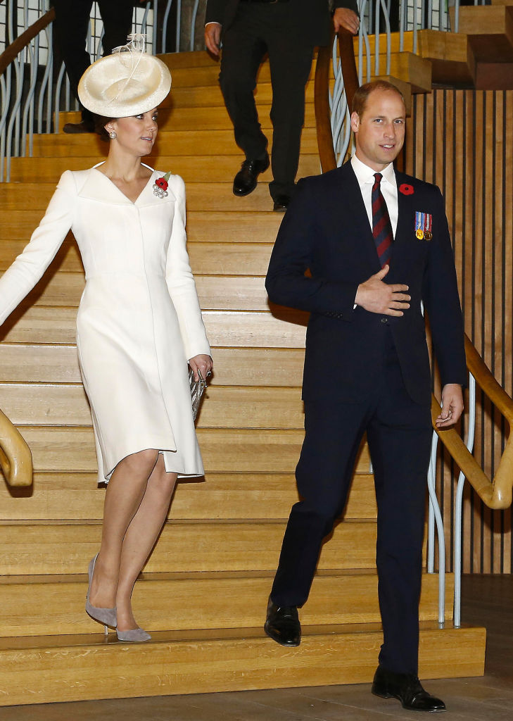 Kate Middleton and Prince William walking down stairs