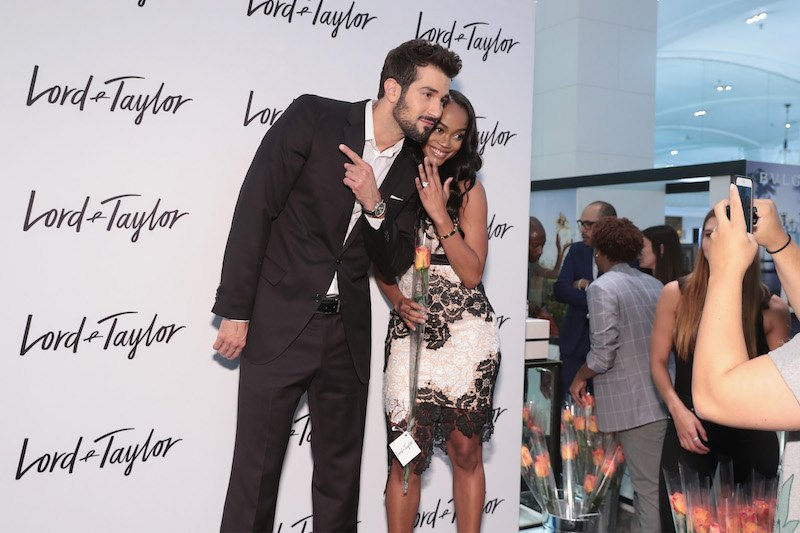 Rachel Lindsay (R) and fiancé Bryan Abasolo visit the Lord & Taylor NYC flagship store