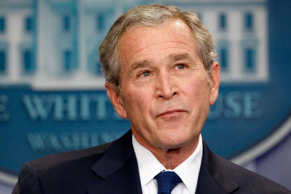 George W. Bush in front of the press.