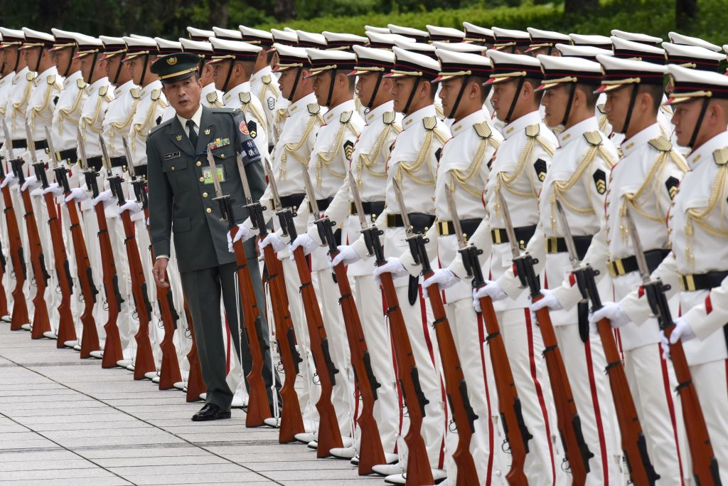 Japan Self-Defence Force honour guards make a line prior to a welcoming ceremony for Japan's Prime Minister Shinzo Abe.