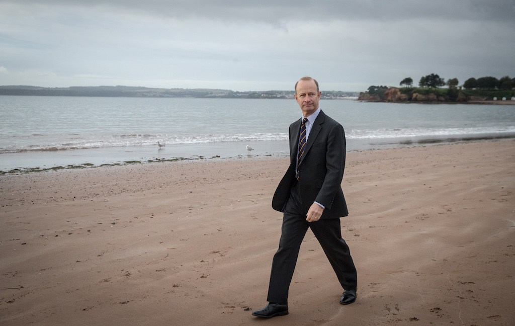 UKIP leader Henry Bolton walks on the beach following morning TV interviews at their autumn conference on September 30, 2017 in Torquay, England.