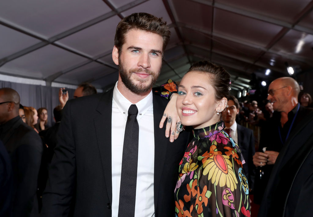 """Liam Hemsworth and Miley Cyrus at The World Premiere of Marvel Studios' """"Thor: Ragnarok"""" at the El Capitan Theatre on October 10, 2017 in Hollywood, California."""