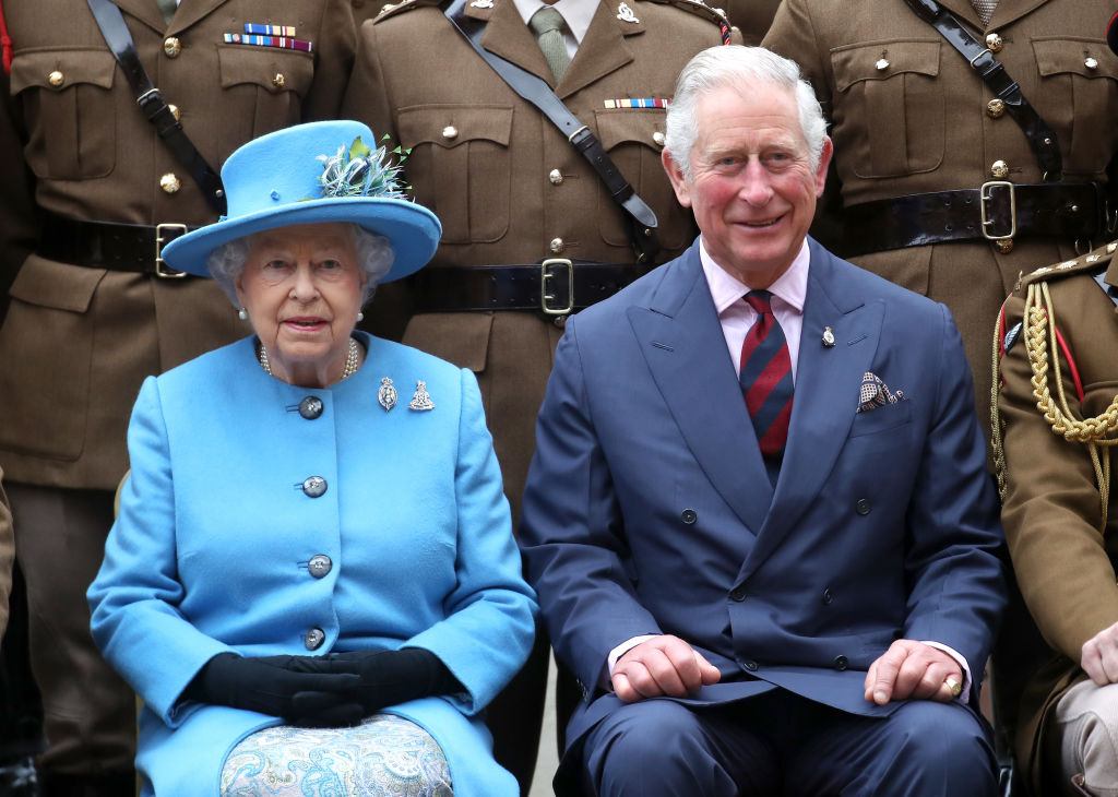 Queen Elizabeth II and Prince Charles, Prince of Wales pose with officers during an official visit to the Household Cavalry Mounted Regiment at Hyde Park Barracks on October 24, 2017 in London, England.
