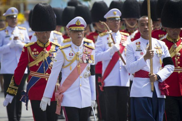 Thai king Maha Vajiralongkorn marches behind the chariots carrying the ashes of his father, the late Thai king Bhumibol Adulyadej.