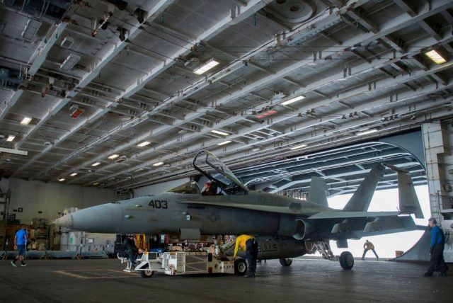 An F/A-18 Hornet is seen in the hangar of the USS George H.W. Bush