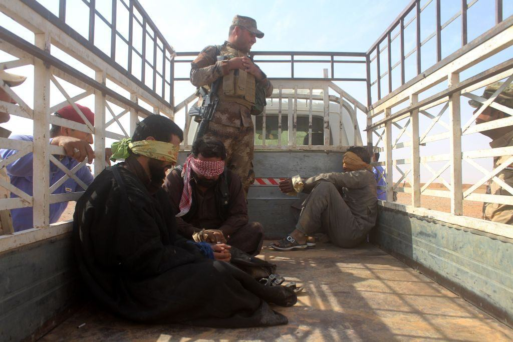 Iraqi pro-government forces detain men suspected of belonging to the Islamic State