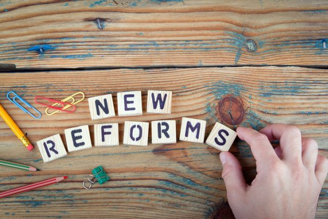 New Reforms. Wooden letters on the office desk. New law