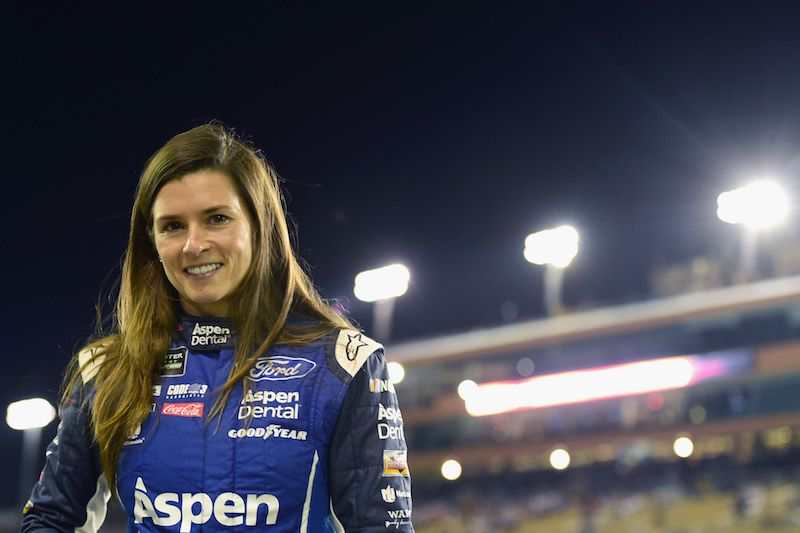 Danica Patrick, driver of the #10 Aspen Dental Ford, stands on the grid during qualifying for the Monster Energy NASCAR Cup Series Championship Ford EcoBoost 400 at Homestead-Miami Speedway on November 17, 2017 in Homestead, Florida