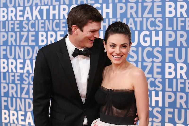Actors Ashton Kutcher (L) and Mila Kunis attend the 2018