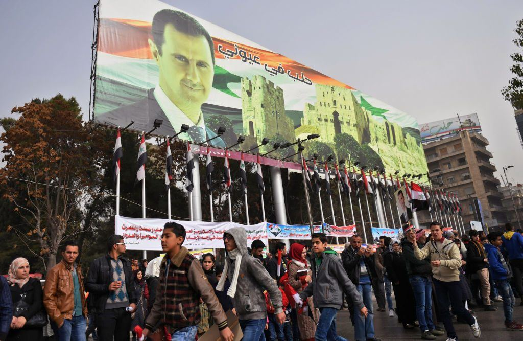 banner depicting President Bashar al-Assad