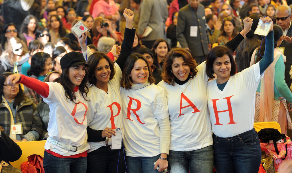 women pose in oprah tshirts