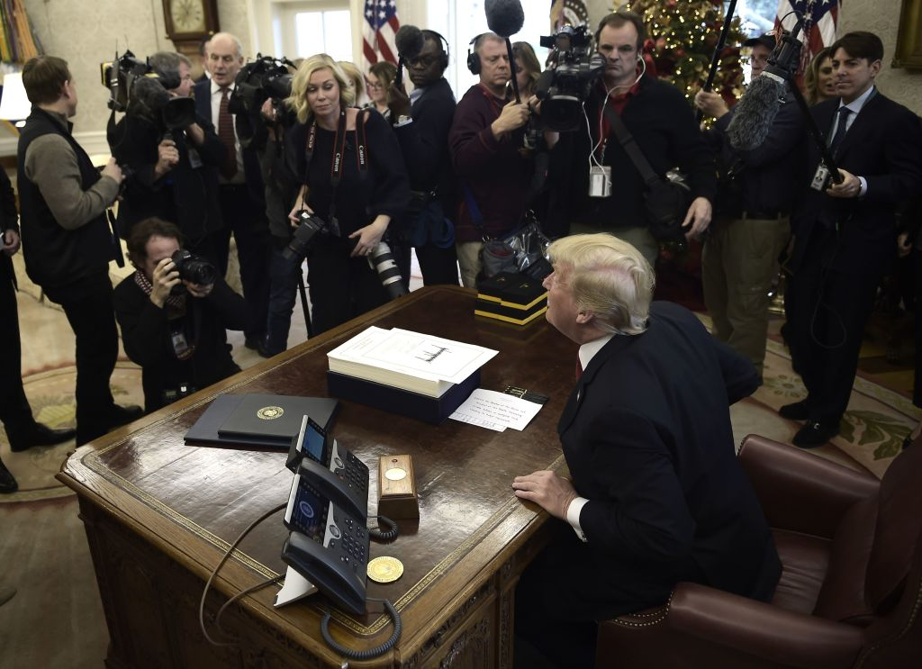 trump surrounded by TV and still cameras