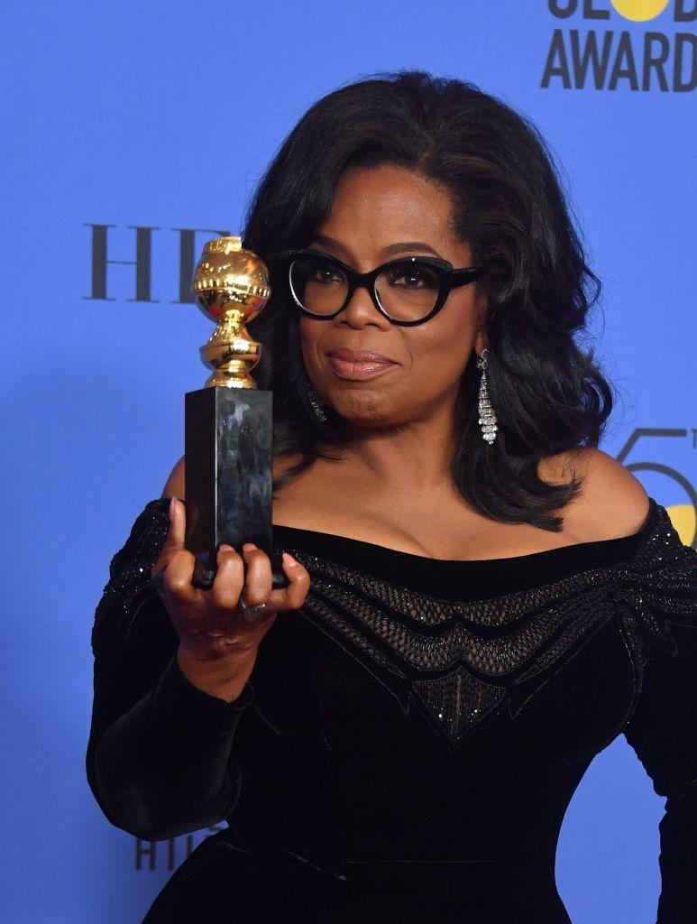 oprah winfrey with her award
