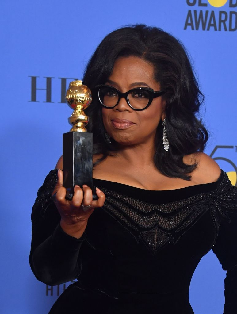 oprah winfrey with her award