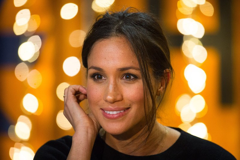 Britain's Prince Harry's fiancée US actress Meghan Markle gestures during a visit to Reprezent 107.3FM community radio station