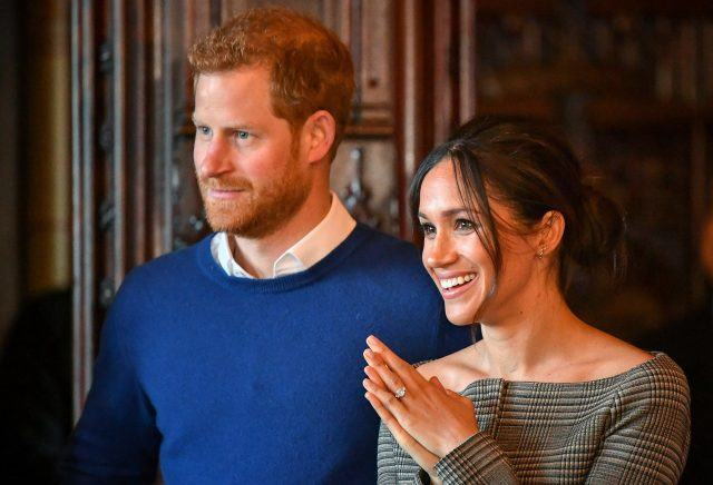 Prince Harry and Meghan Markle watch a performance by a Welsh choir.