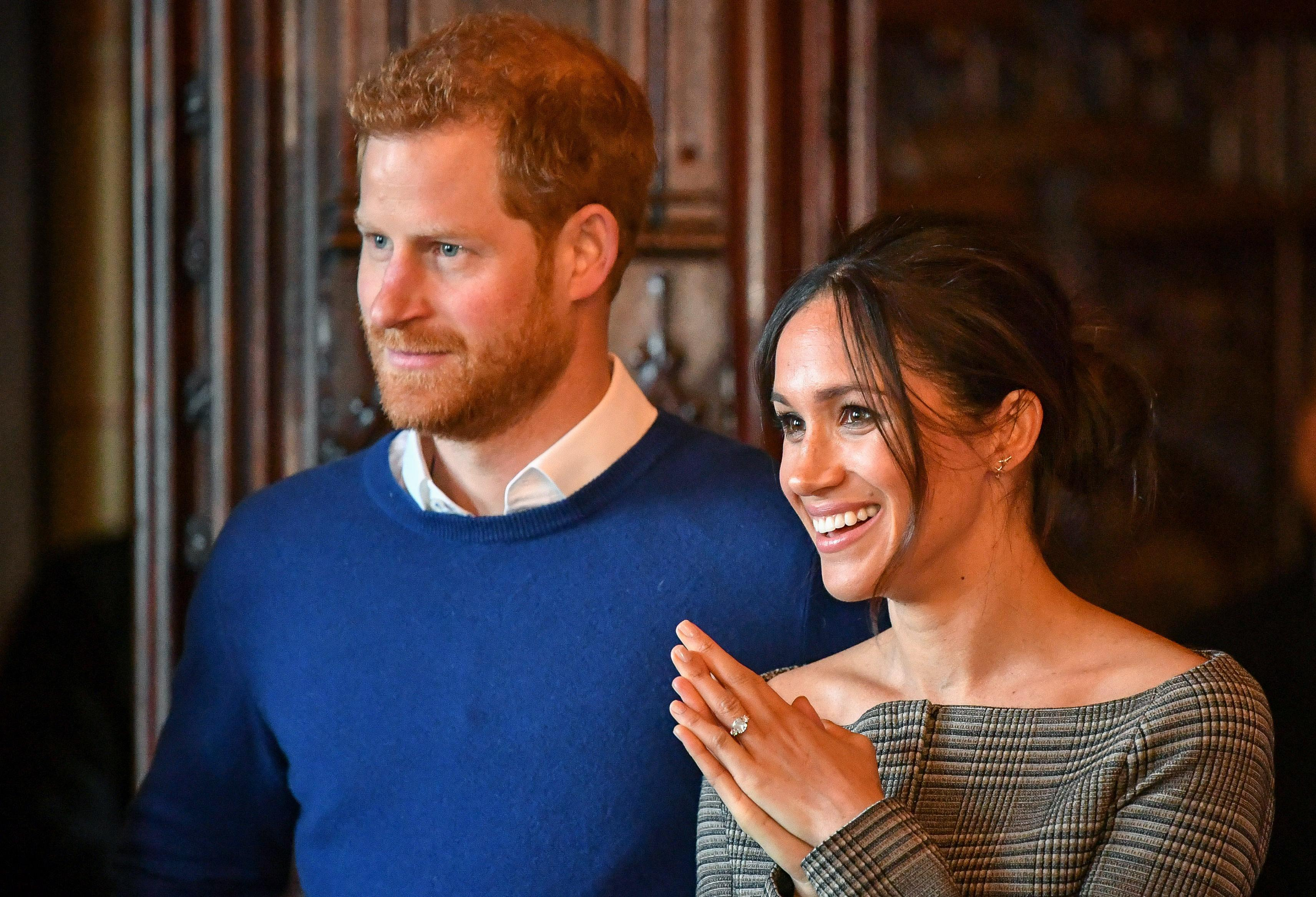 Prince Harry and Meghan Markle watch a performance by a Welsh choir i