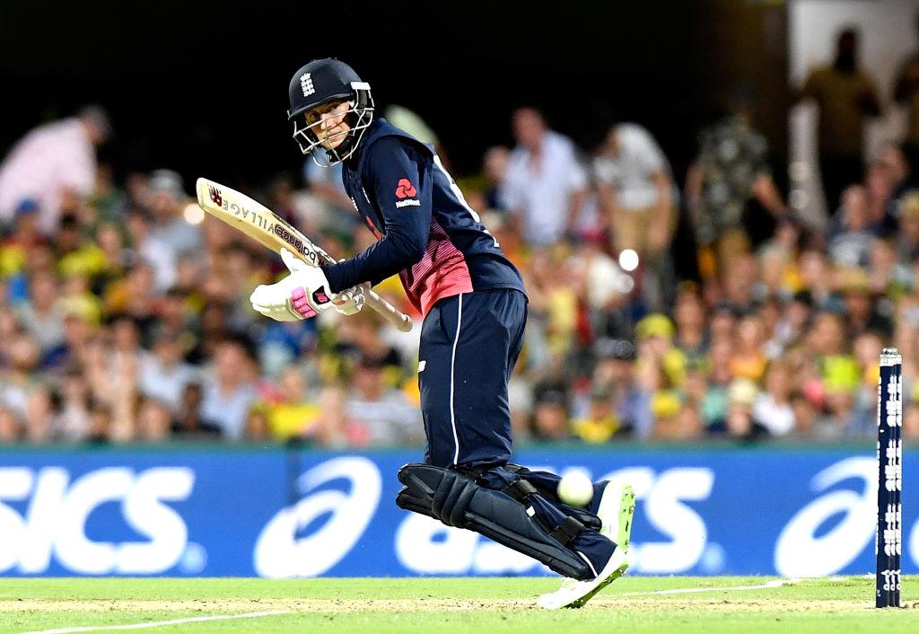 Cricket player plays a shot