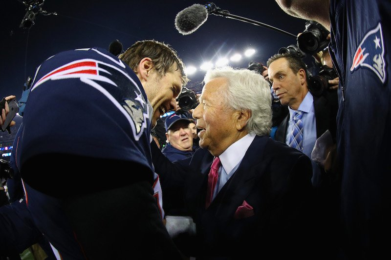 Tom Brady #12 of the New England Patriots celebrates with owner Robert Kraft after winning the AFC Championship Game