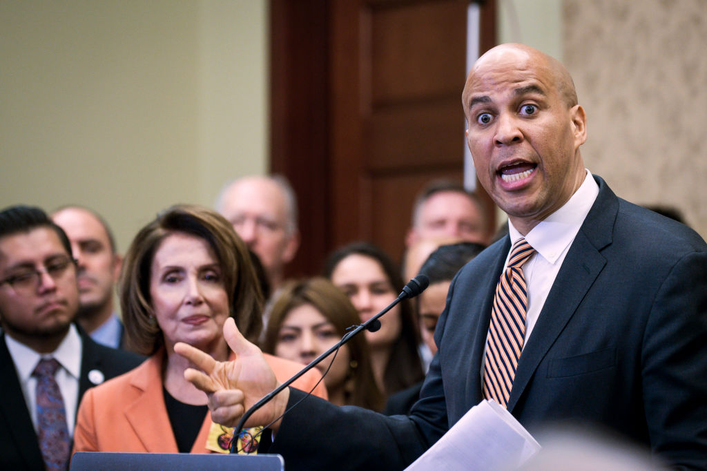 Booker (D-NJ) speaks during a press conference with Dreamers who will be attending President Trump's first State of the Union Address on January 30, 2018 in Washington, DC. Democratic leaders from both Houses of Congress welcomed the largest group of Dreamers to attend a State of the Union Address.