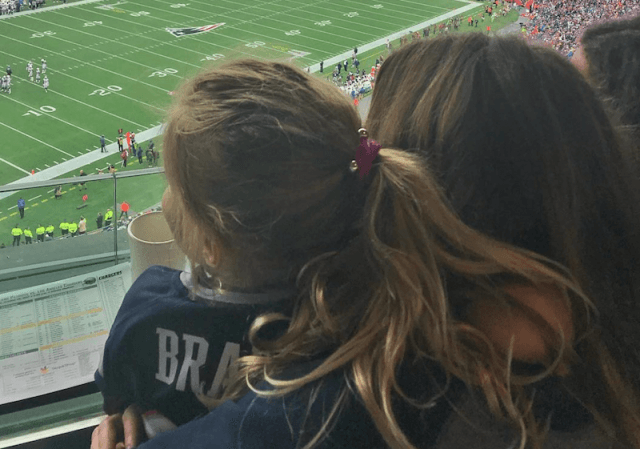 Gisele and Vivian watching a football game.