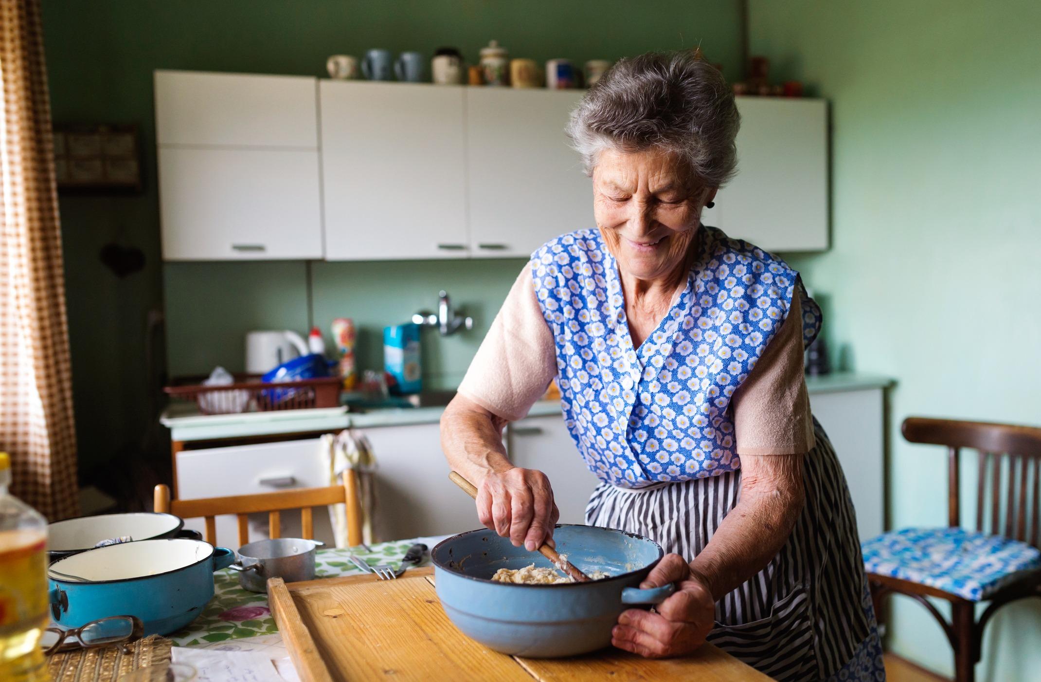 Senior woman or grandmother baking