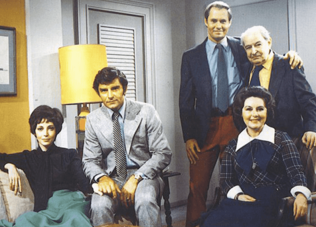 The cast of 'Guiding Light' sitting together inside an apartment.