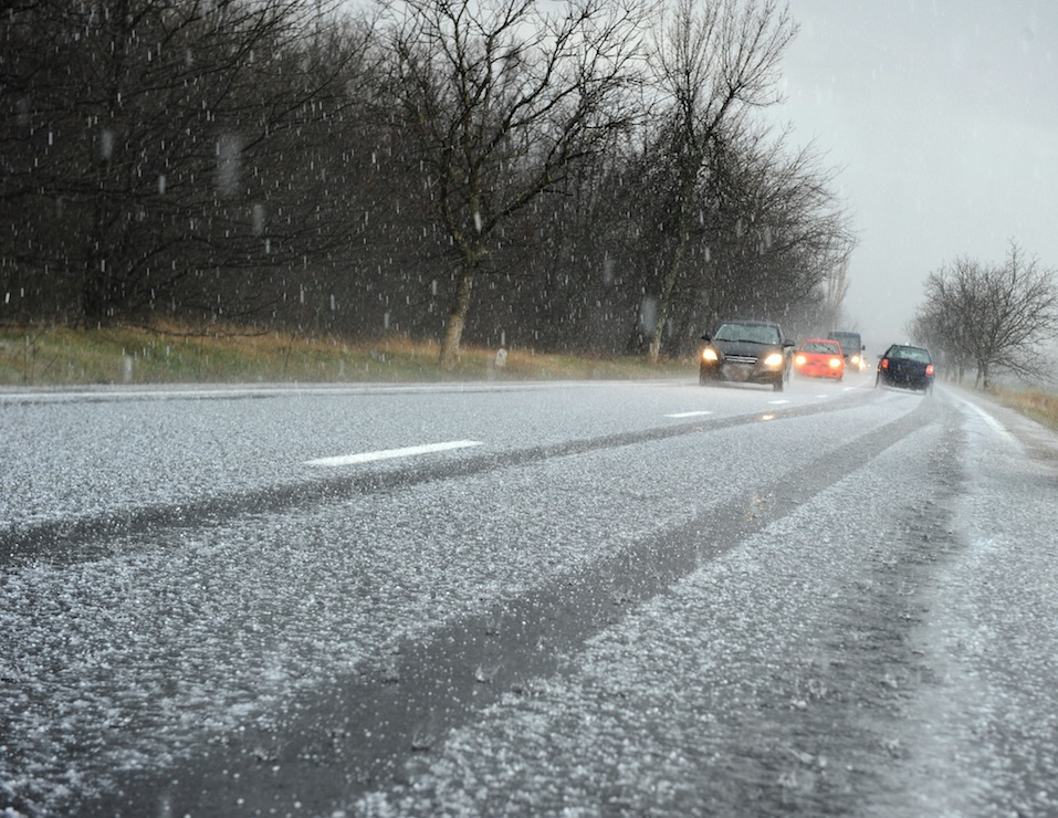 Hailstorm on the road in a summer day