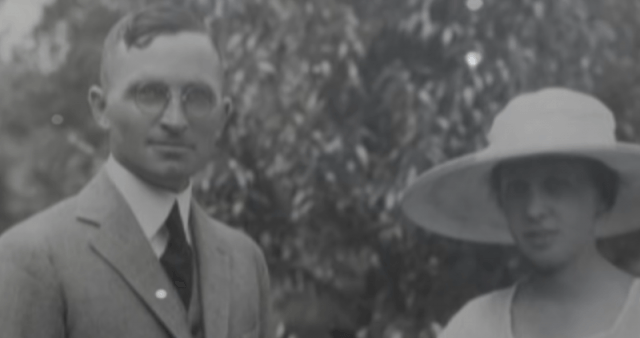 Harry and Bess Truman standing in a garden.