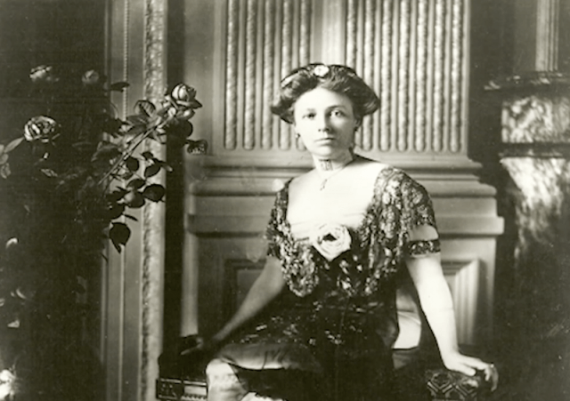 Helen Taft sitting in a parlor.