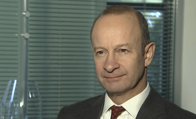 Henry Bolton smiling while answering interview questions.