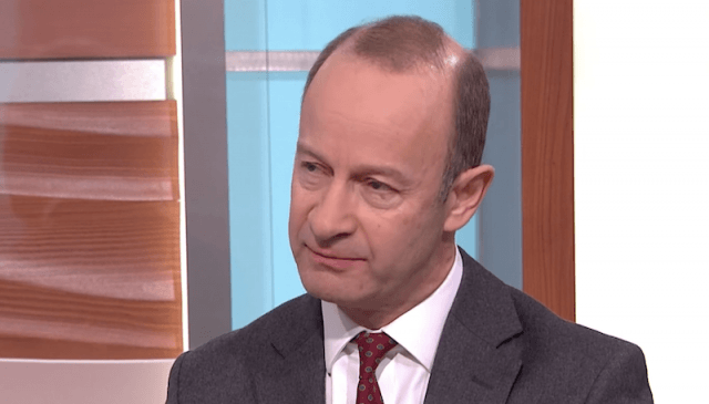 Henry Bolton sitting on a couch during a talk show interview.