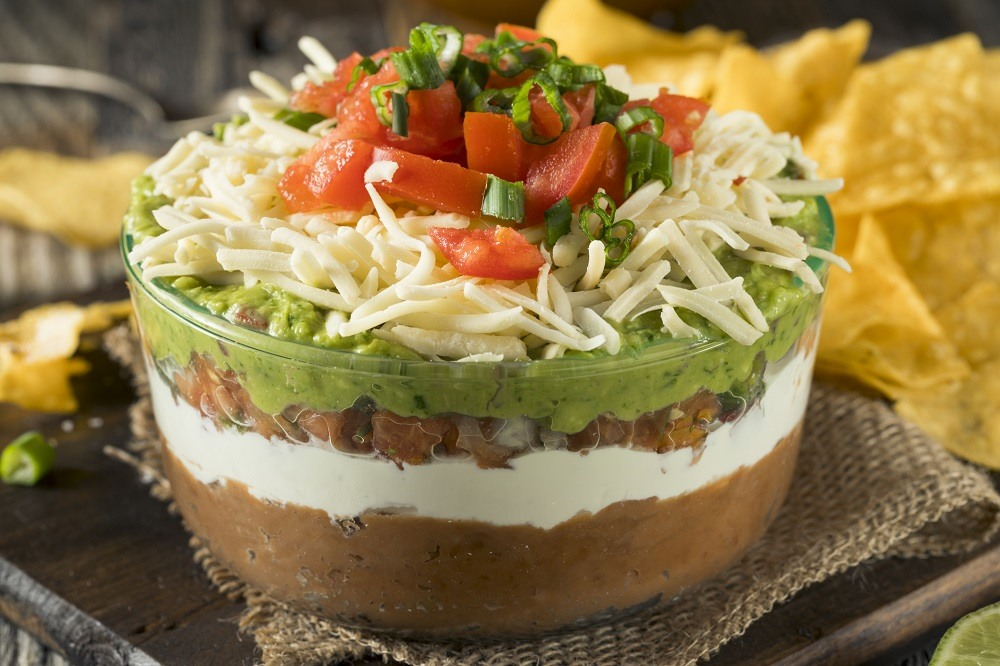 Layer Dip with Beans, Sour Cream and Guacamole