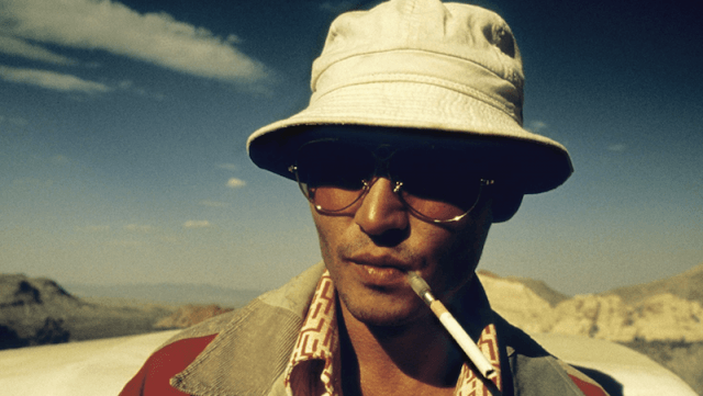 Johnny Depp standing in front of a car and smoking a cigarette as Thompson .